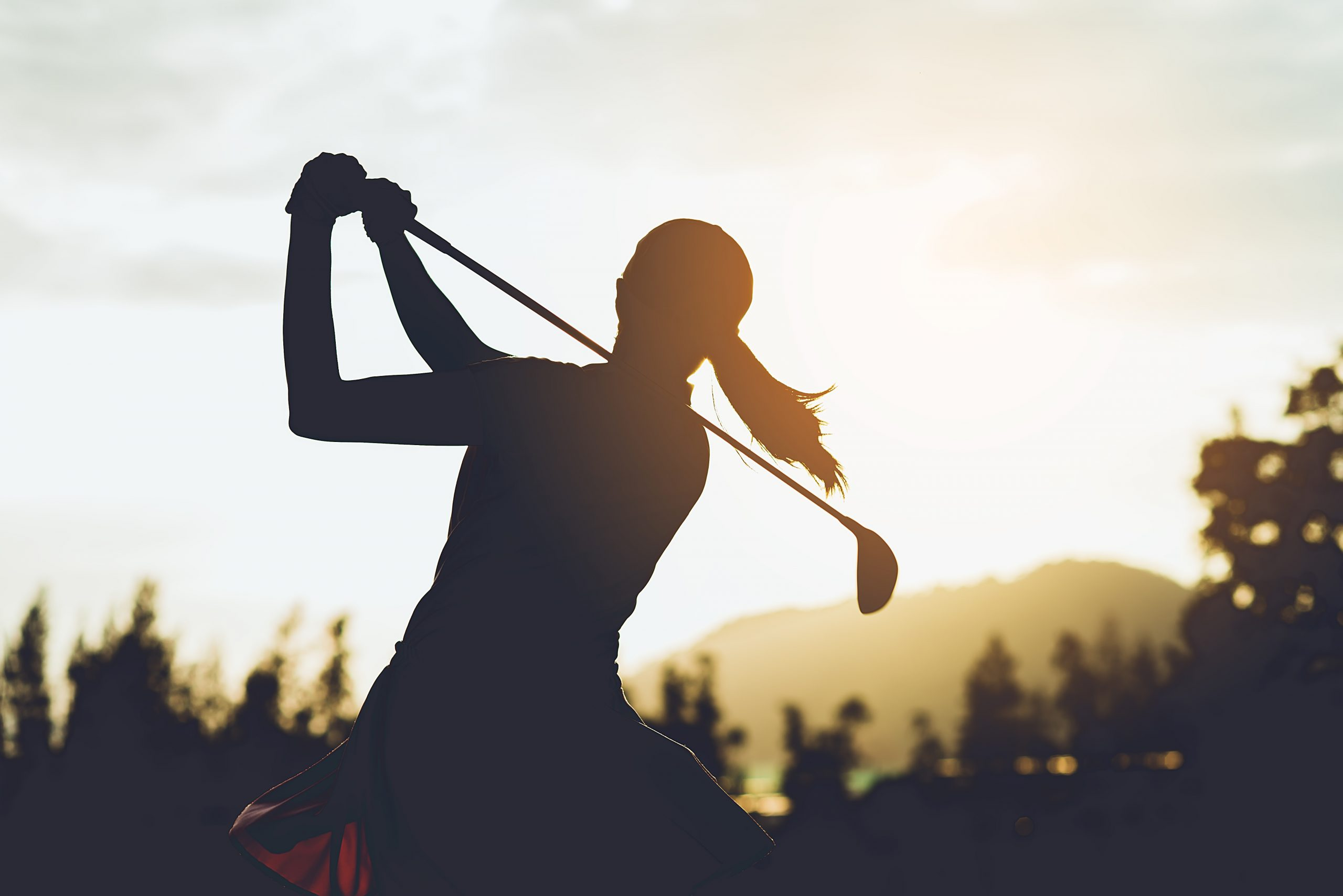 silhouette-young-female-golf-player-hit-sweeping-keep-golf-course-doing-golf-swing-she-does-exercise-relax-time-vintage-tone-scaled